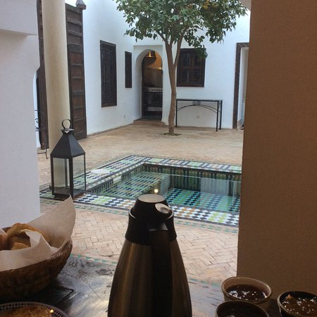 Riad Porte Royale: This is a perspective of the open courtyard from an eating area.