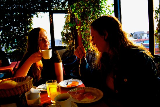 Hotel Canada: My friends enjoying the complimentary breakfast on the hotel rooftop