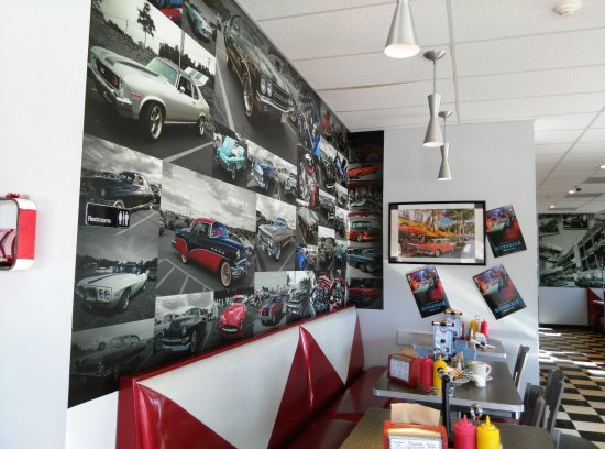 North Attleboro, MA: Huge car mural over red & white booths