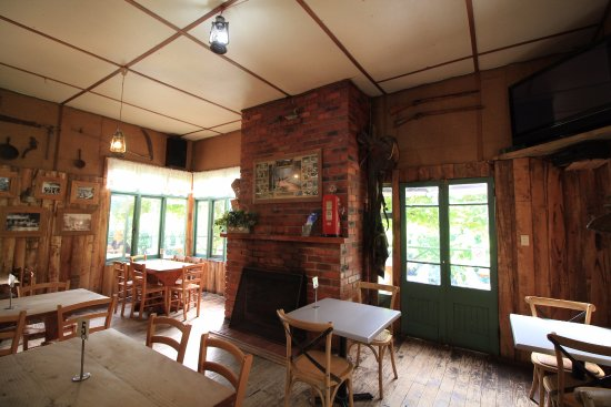 The Blue Duck Inn Hotel Pub: the fireplace and seating area