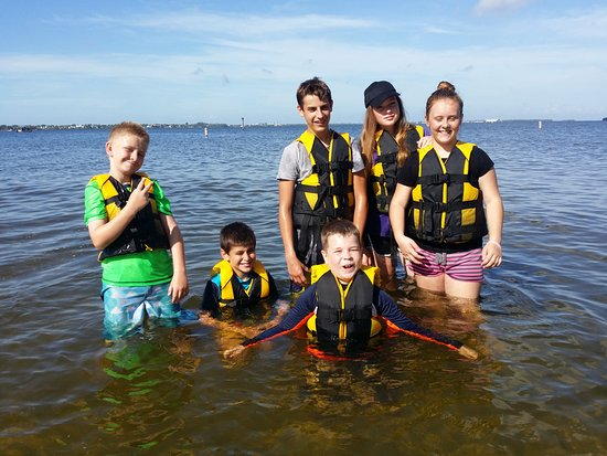 Kayak Charters: Kids learning water safety.