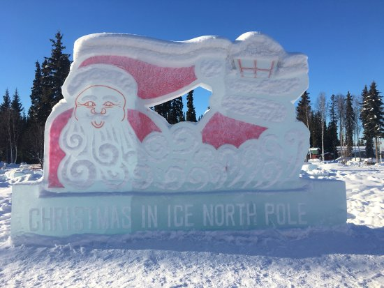 Santa Claus House: The North Pole Pole  Santas house and the ice sculptures outside