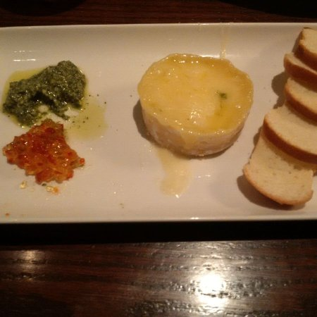 Aurora, Canada: Baked Brie with pepper jelly and pesto