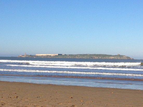 Essaouira Beach: View of one island & gentle waves coming towards the beach