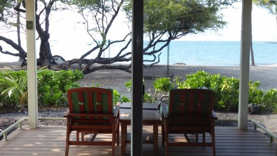 Lava Lava Beach Club Cottages : front porch and view.  there are also 2 chaise beach chairs in front of cottage