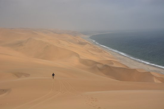 Walvis Bay, Namibia: Dale going down the dune to film us passing by.