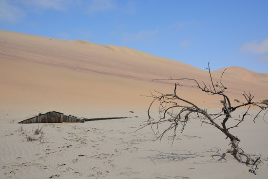 Walvis Bay, Namibia: Abandoned fishing hut covered in sand: The dunes reclaim their domain.