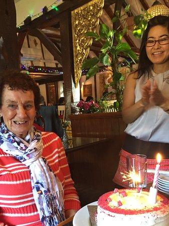 Lingfield, UK: Staff giving Mum her cake