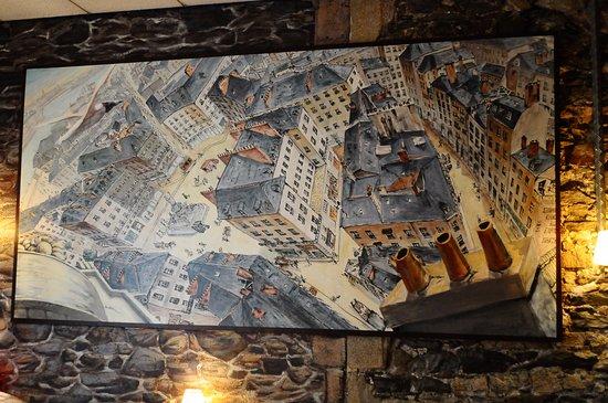 La Tete Noire : Un grand tableau donnant la vue d'une mouette survolant le centre ville.