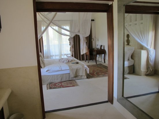 Swahili Beach Resort: This is a view of the bedroom from the bathroom, which has a wall length mirror on one side