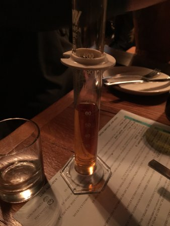 North Aurora, IL: The Woodford K&B Bourbon created by Hardware, Excellent!!  Appropriate server in test tube as th