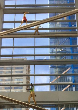 Comcast Experience: Human figures ascending in the interior