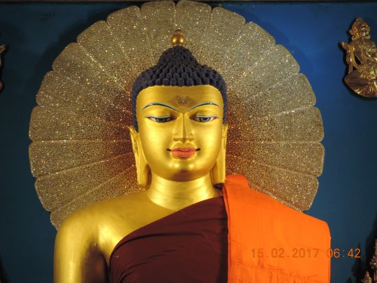 close up of lord buddha idol picture of mahabodhi temple bodh