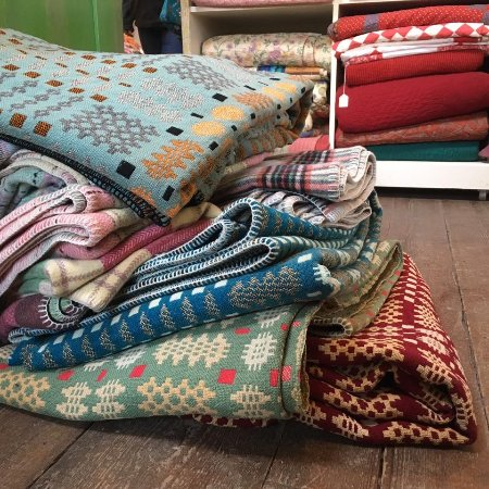 Tregaron, UK: A pile of blankets, the top one of which had recently been used to create new ones based on it.