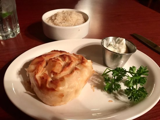 Ladysmith, Canada: Tiropita, a Greek cheese pie entombed in phyllo pastry with a side of rice pilaf and tzatziki sa