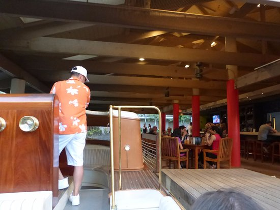 A canal boat comes into discharge passengers at the Boat Landing Cantina