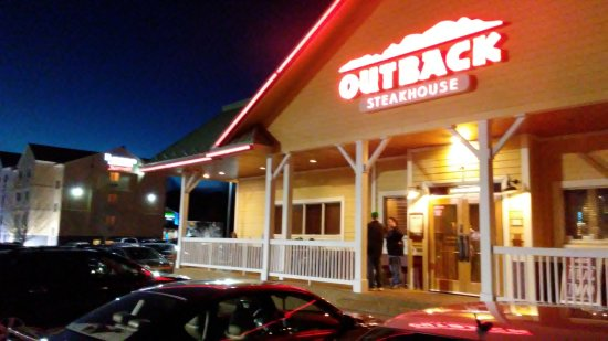Outback Steakhouse: The front of the restaurant from the parking lot.