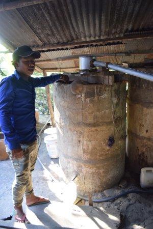 Battambang, Cambodia: Pitou explaining how to make rice wine