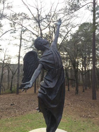 Milledgeville, GA: Follow the short path to see the guardian angel placed over the graves from Georgia State Hospit