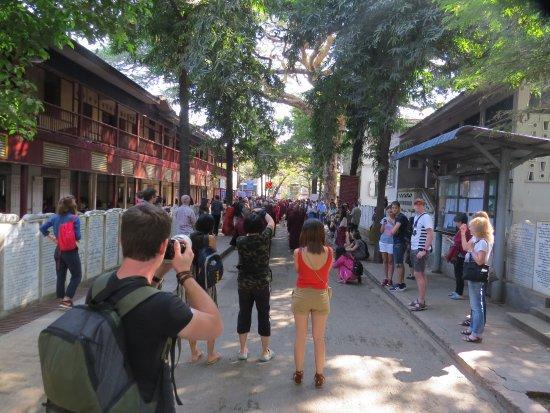 Amarapura, Burma: tourists fishing for monk photos