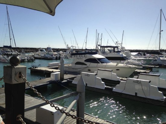 Gordon's Bay, แอฟริกาใต้: View of boats moored next to the deck.
