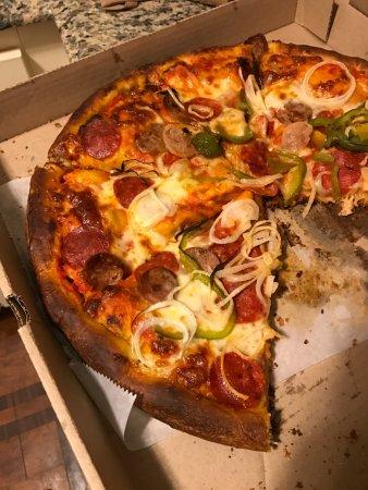 New York City Pizza: Notice overcooked pizza crust...