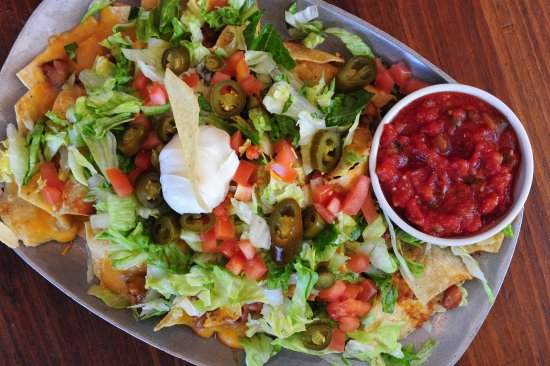 Shorty Small's: Macho Nachos: Tortilla Chips with chili, jack & cheddar cheeses, tomatoes & jalapeños.