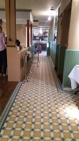 Cults Hotel: The new floor tiles and green-painted wood in the dining area.