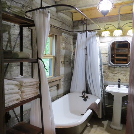 Elizabethtown, IL: Twin Oaks log cabin bathroom with antique clawfoot tub/shower