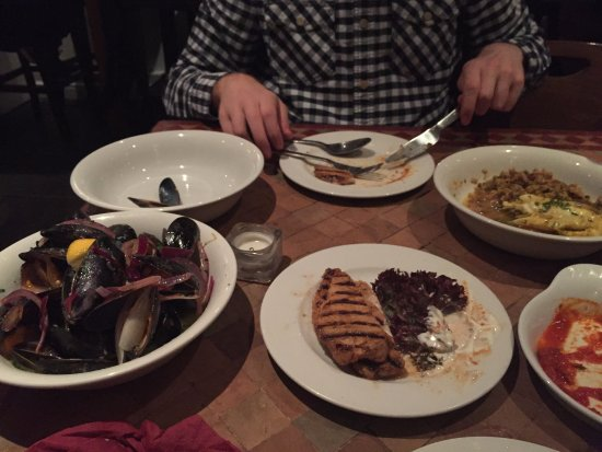 Holmfirth, UK: Mussels and Pork Izgara with Haddock tagine in background - too busy eating, not enough photos :