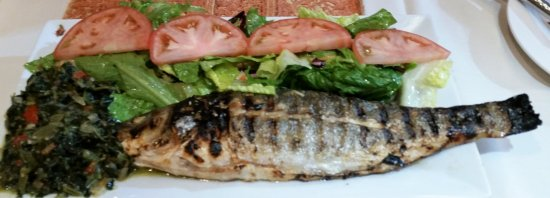 Clifton Park, Estado de Nueva York: Char grilled bronzini with sautéed spinach and house salad.