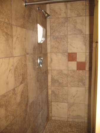 roomy shower stall with personal/private changing area with wall ...