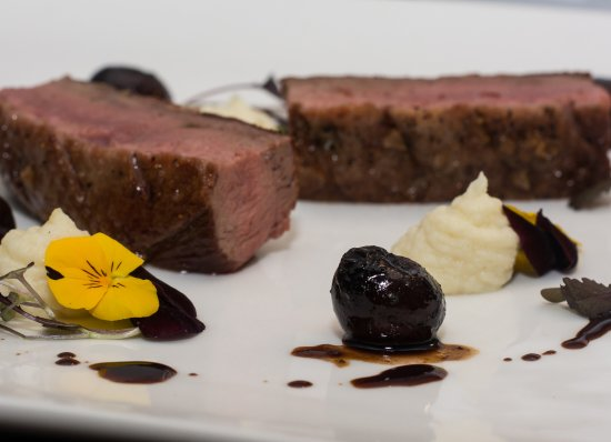 Scunthorpe, UK: Oven Roasted Duck with celeriac puree, dark cherries and a chinese five spiced reduction