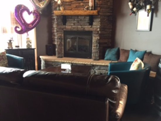 Tastebuds Coffee & Wine: The fireplace and seating area