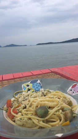 Caoutchouc Restaurant: Chicken curry pasta on the porch. Not shown: wine and the sunshine that came out soon after