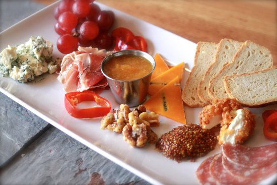 Plymouth, MI: charcuterie board:variety of meats, cheeses, jam,  mustard, pickled veg, crackers, nuts, fruit,