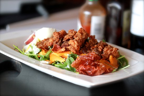 Plymouth, MI: country steak salad: chicken fried steak, red skin potato, cellar aged cheddar, poached egg