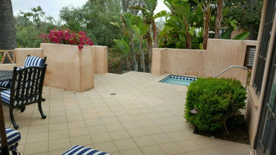 Rancho Valencia: Talk about a patio! with lounge chairs and table with chairs for dining