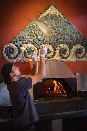 Richmond, Nowa Zelandia: Our wood-fired pizzas start with a dough recipe that is generations old. Hand-tossed perfection!
