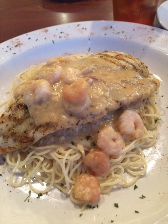 LaPlace, LA: Grilled catfish over penne pasta with shrimp/crab sauce, and a side salad