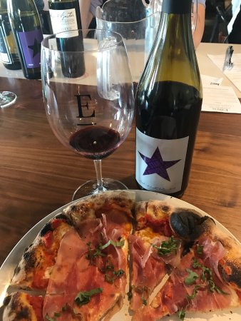"Richland, WA: The ""razor back"" lunch pizza with Purple Star Syrah."