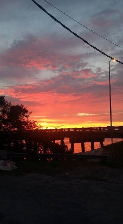 Beautiful sunset over Cortez bridge taken from Tide Tables