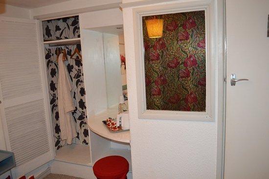 Eden Lodge: damp peeling wallpaper