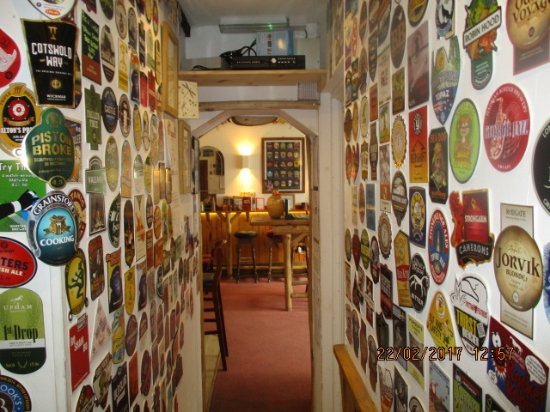 Minster, UK : Hallway of the Pump clips of beer consumed