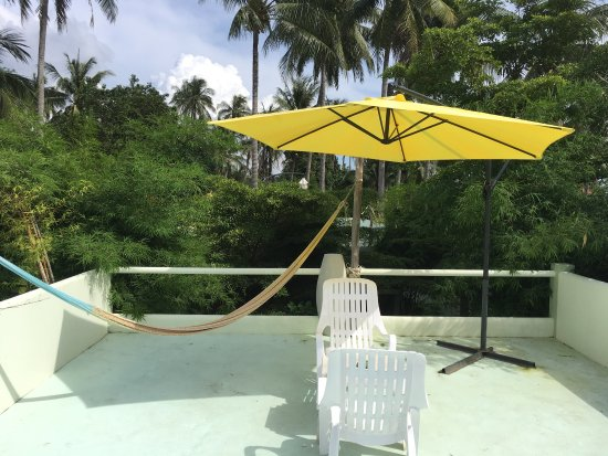 Le Divine Comedie: Hammock, seating, and umbrella provided in the private rooftop area