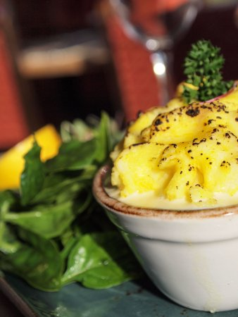 Reedham, UK: Fisher-mans Pie, Topped with Saffron Mash & Norfolk Dapple Cheese, with Wilted Baby Spinach