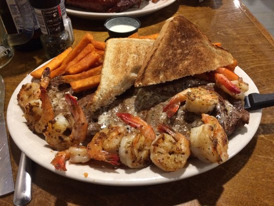 Mike's Catfish Inn: Deep fried Pickles, Salad Bar, BBQ Ribs with Sweet Potato Fries, Grilled Steak and Shrimp with S