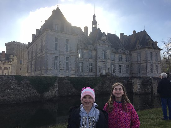 Saint-Loup-Lamaire, Prancis: our daughters in front of the moat that surrounds the Chateau and the Keep