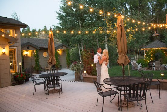 South Fork, CO: Wedding couple dancing on the deck