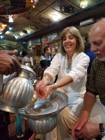 Yod Abyssinia Traditional Food : Washing our hands with soap and water before dinner....a tradition.